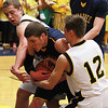 Record-Eagle/Keith King<br /> Glen Lake's Mike O'Brien, left, and Curtis Bunek, right, as well as Negaunee's Andrew Katona, middle, battle for possession of the ball Tuesday, March 19, 2013 at Gaylord High School.