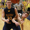Record-Eagle/Keith King<br /> Negaunee's Tanner Uren (23), left, and Glen Lake's Carter Lee, right, battle for possession of the ball Tuesday, March 19, 2013 at Gaylord High School.