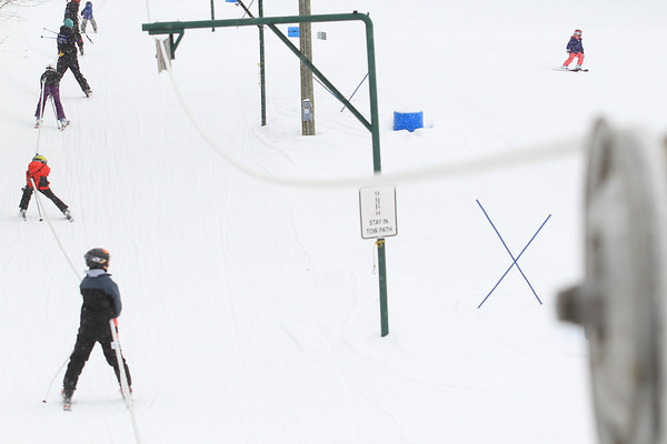 Record-Eagle/Keith King<br /> Skiers travel up and down a hill Tuesday at Hickory Hills Ski Area in Traverse City.