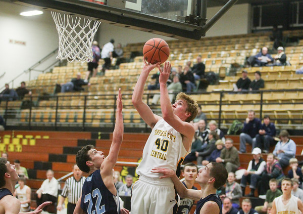 Record-Eagle/Keith King<br /> Traverse City Central's Max Knoblock (40) shoots the ball against Petoskey Monday at Traverse City Central High School.