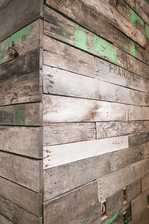 Record-Eagle/Keith King<br /> Pieces of oak apple crates are used on a wall as work takes place to open Rare Bird Brewpub in Traverse City.