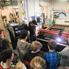 Record-Eagle/Keith King<br /> William James, a student in the Traverse Bay Area Intermediate School District (TBAISD) Career-Tech Center (CTC) welding program, demonstrates a CNC plasma cutter Wednesday to Glen Lake Middle School eighth-grade students.