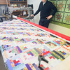 Record-Eagle/Keith King<br /> David Lint, of Elmwood Township, explains how he quilts utilizing a quilting machine.