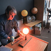 Record-Eagle/Keith King<br /> Dr. Jerry Dobek sets up a model which shows the effects of solar and lunar eclipses as he prepares to teach a Northwestern Michigan College (NMC) astronomy class at NMC's Joseph H. Rogers Observatory.