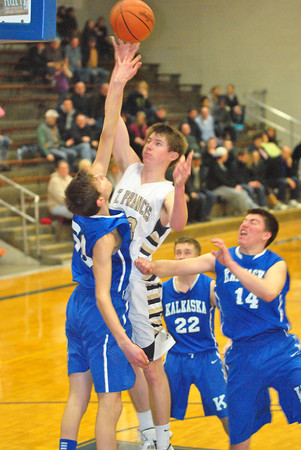 Record-Eagle/James Cook<br /> Traverse City Central's Devante Walker (50) puts up a shot against Petoskey on Monday.