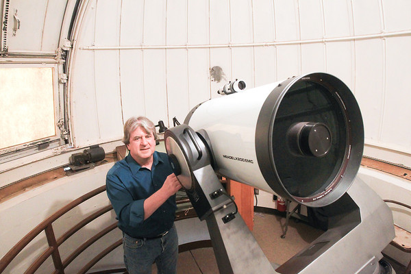 Record-Eagle/Keith King<br /> Dr. Jerry Dobek stands near a 16-inch telescope at Northwestern Michigan College's Joseph H. Rogers Observatory.