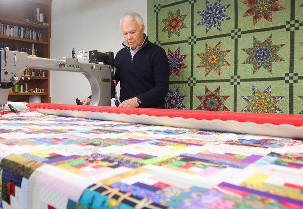 Record-Eagle/Keith King<br /> David Lint, of Elmwood Township, demonstrates how he uses a quilting a machine.