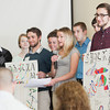 Record-Eagle/Keith King<br /> Abigail Hill speaks as Justin Cutler, front left, and Adam Canute, front right, standing near fellow team members, hold posters during a team presentation Wednesday during the Junior Achievement of Northwest Michigan second annual Youth Summit for Future Entrepreneurs in the Hagerty Conference Center at the Northwestern Michigan College Great Lakes Campus.