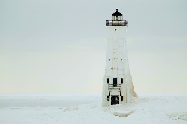 Record-Eagle/Keith King<br /> The Frankfort North Breakwater Light stands near ice on Lake Michigan.