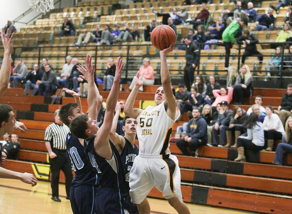 Record-Eagle/Keith King<br /> Traverse City Central's Devante Walker (50) shoots the ball against Petoskey Monday at Traverse City Central High School.