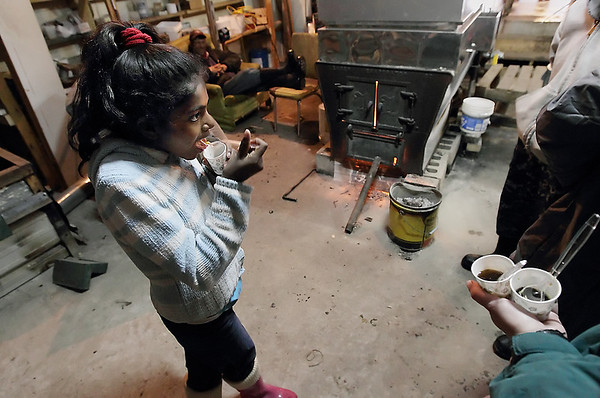 Record-Eagle/Keith King<br /> Shalini Augenstein, 10, of Traverse City, tastes fresh maple syrup Saturday at Still Point Farm in Empire.