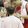 Record-Eagle/Jan-Michael Stump<br /> Suttons Bay's Dwuan Anderson signs autographs after a win at Traverse City Central.