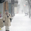 Record-Eagle/Keith King<br /> Victoria Sutherland, of Traverse City, walks through a snowy downtown Traverse City on Wednesday.
