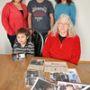 Record-Eagle/Vanessa McCray<br /> Jacob Cabinaw's family continue to search for answers after the Grawn man went missing nearly a year ago. A pile of photographs and newspaper clippings are reminders from the long year filled with unanswered questions. Front row from left, Cabinaw's son Zander, 7; and mother Mavis Clous. Back row from left, his ex-wife Rachel; son Jacob, 13; and sister Sandra Cranson.