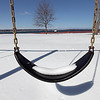 Record-Eagle/Keith King<br /> Snow lies on a swing at Bryant Park in Traverse City.