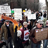 Record-Eagle/Keith King<br /> Protesters rally in downtown Traverse City on Saturday against Gov. Rick Snyder's proposed budget.