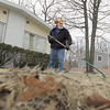"Record-Eagle/Keith King<br /> Ron Sheffer, of Traverse City, rakes leaves and debris for his neighbor and himself Tuesday in front of the duplex he lives in. ""It's good working weather,"" said Sheffer, who used to be an employee for the City of Traverse City before retiring after 32  years."
