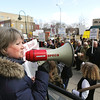 Record-Eagle/Keith King<br /> Gwenne Allgaier, of Maple City, addresses protesters as they rally along Union Street in front of the United States Post Office in Traverse City.