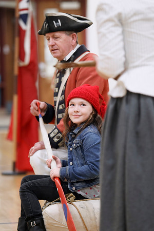 """Record-Eagle/Pete Rodman<br /> Museum interpreter Jim Evans, left, helps Caitlen Gootee """"paddle"""" during the Colonial Michilimackinac State Park's """"Mackinac History on Tour"""" event at John R. Rodger Elementary School in Bellaire."""