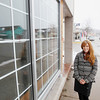Record-Eagle/Keith King<br /> Pam Leonard, owner, stands Tuesday, March 12, 2013 outside a building at the intersection of St. Joseph Street and Madison Street in Suttons Bay. The building, which was formerly the site of Silvertree Deli, is planned to be Wine Country Marketplace in the lower level and a hotel in the upper level.