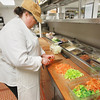 Record-Eagle/Keith King<br /> Rhonda Nugent, chef and general manager, cuts vegetables as she prepares beef barley soup Friday, March 22, 2013 at the Brookside Inn in Beulah.