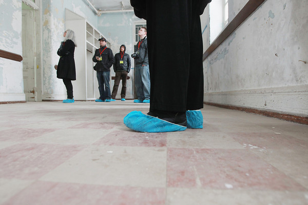 Record-Eagle/Keith King<br /> Booties are worn Thursday, March 21, 2013 by members of a group touring Building 50 of the former Traverse City State Hospital, now known as the Village at Grand Traverse Commons. The booties are worn to minimize the amount of lead-based paint contact.