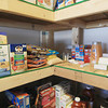 Record-Eagle/Keith King<br /> Items lie on shelves Friday, March 29, 2013 at the Kingsley Baptist Church food bank.