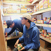 Record-Eagle/Keith King<br /> John Harrison, left, and Dan Shively, both of Kingsley both members of Kingsley Baptist Church, organize items Friday, March 29, 2013 at the Kingsley Baptist Church food bank.