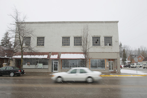 Record-Eagle/Keith King<br /> The building that was formerly the home of Silvertree Deli stands Tuesday, March 12, 2013 at the intersection of St. Joseph Street and Madison Street in Suttons Bay with plans for it to be Wine Country Marketplace with a planned hotel for the upper level.