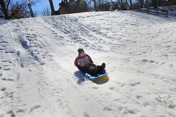 Record-Eagle/Keith King<br /> Helen Myler, 7, of Traverse City, sleds Wednesday, March 27, 2013 at Hannah Park during her spring break.