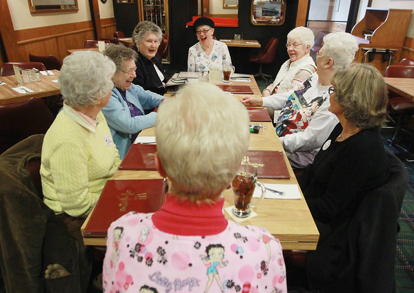 Record-Eagle/Keith King<br /> Betty VanRiper, from left, Betty Hentschel, Betty Beutler, Betty Hammond, Betty Koons, Betty Harmon and Betty Monahan, as well as Betty Plough, bottom, all members of Bettys by the Bay, laugh Wednesday, March 20, 2013 as they meet for lunch at Mode's Bum Steer in Traverse City.