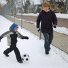 "Record-Eagle/Keith King<br /> Daniel Kotsekon, 5, of Traverse City, and his mother, Tanya Kotsekon, play soccer Monday, March 25, 2013 at Central Grade School in Traverse City. ""He loves soccer,"" Kotsekon said."
