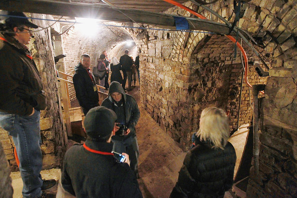 Record-Eagle/Keith King<br /> A group takes a tour guided by Raymond Minervini, far left, a partner with the Minervini Group, as they stand Thursday, March 21, 2013 in tunnels under the former Traverse City State Hospital, now known as the Village at Grand Traverse Commons.