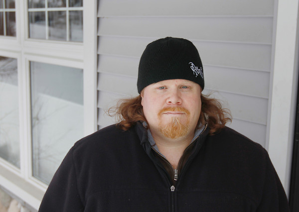 Record-Eagle/Keith King<br /> Caleb Smith, of Traverse City, stands Wednesday, March 20, 2013 at his home.