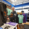 "Record-Eagle/Dan Nielsen<br /> Store manager Cyndi Kremer demonstrates the ""beer koozie"" built into some of Livnfresh's hoodies."