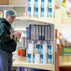 Record-Eagle/Jan-Michael Stump<br /> Volunteer Steve Laske stocks shelves in the food pantry at Benzie Area Christian Neighbors in Benzonia, which also offers clothing, GED classes and support services for area residents.