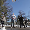 Record-Eagle/Keith King<br /> From left to right, Branden Saylor, Josh Maloney, CC Carter and Josh Vander Meulen, all of Traverse City, play basketball on a partially snow-cleared court Tuesday at the Grand Traverse County Civic Center.