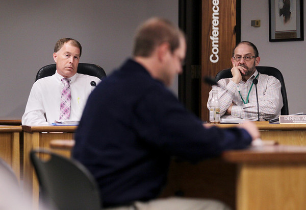 Record-Eagle/Keith King<br /> Grand Traverse County Finance Director, Dean Bott, left, and Administrator Dennis Aloia, right, listen during Wednesday's board meeting.