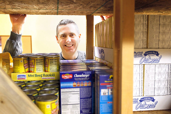 Record-Eagle/Jan-Michael Stump<br /> Fresh Wind Christian Community Church pastor Chuck Towesey stands in the church's food pantry  in Honor.