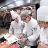 "Record-Eagle/Keith King<br /> Chef instructor Harlan ""Pete"" Peterson, center, talks with students Heather Bradley, left, and Lee Arnold, right, during a professional cookery class at the Great Lakes Culinary Institute."