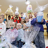 Record-Eagle/Jan-Michael Stump<br /> Fresh Wind Christian Community members hold some of the Easter baskets the Benzie County church is selling to raise money for its food pantry. Fresh Wind is also holding a silent auction, spaghetti dinner and concert April 8 and 9.
