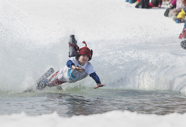 Record-Eagle/Keith King<br /> Andy Similuk, 12, of Waterford, takes a spill Saturday, March 2, 2013 during the annual Slush Cup at Shanty Creek Resorts' Schuss Mountain in Bellaire.
