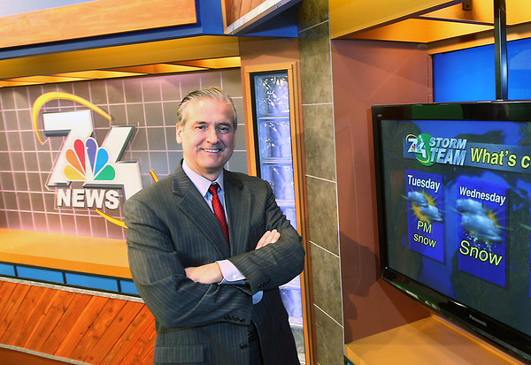 Record-Eagle/Keith King<br /> Mark Watkins, TV 7&4 chief meteorologist, stands Tuesday, February 26, 2013 in the TV 7&4 studio in Elmwood Township.