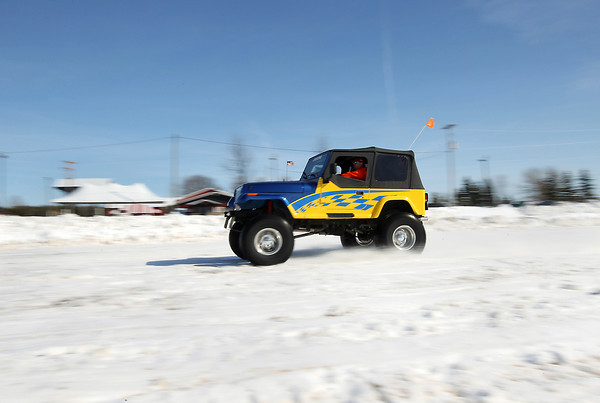 Record-Eagle/Keith King<br /> Kevin Jefferson, of Traverse City, drives a Jeep to check snow conditions Friday, March 8, 2013 as preparations are made for the 4x4 Polar Drags scheduled for Saturday, March 9, 2013 at the Southside Festival Grounds in Buckley.