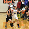 Record-Eagle/Jan-Michael Stump<br /> Leland's Maggie Osorio (21) chases Gaylord St. Mary's Kari Borowiak (11) down the court in the second period of Tuesday's Class D regional semifinal in Buckley.