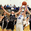 Record-Eagle/Jan-Michael Stump<br /> Leland's Caitlin McKee (22) and Miranda Harrison (13) fight for a rebound with Gaylord St. Mary's Sarah Long (25) in the second quarter of Tuesday's Class D regional semifinal in Buckley.
