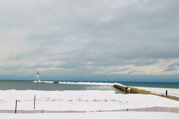 Record-Eagle/Keith King<br /> The north breakwater light in Lake Michigan Wednesday, March 6, 2013 in Frankfort.