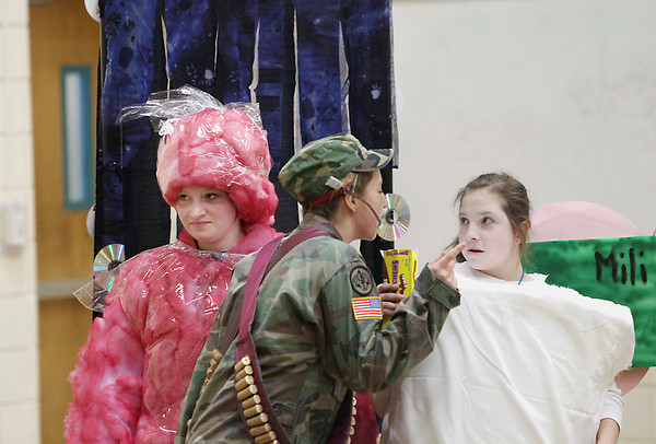 Record-Eagle/Keith King<br /> Natalee Hill, from left, Charlotte Drumm and Megan Dessauer, Cherryland Middle School (Elk Rapids) students, compete with their teammates Saturday, March 2, 2013 during the Michigan Odyssey of the Mind Region 3 tournament at Traverse City East Middle School.