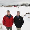 Record-Eagle/Keith King<br /> Tony Anderson, left, general manager of Cherryland Electric Cooperative, and Tim Arends, interim executive director/ controller of Traverse City Light and Power, stand Wednesday, March 6, 2013 at Cherryland Electric Cooperative in Blair Township near the location of where solar panels are planned to be placed.