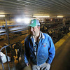 Record-Eagle/Keith King<br /> Doug Gallagher, stands Tuesday, March 5, 2013 near his Holstein dairy cows at Gallagher's Centennial Farm on North Long Lake Road.